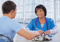 Asian female doctor speaking with patient Royalty Free Stock Photo
