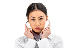 Asian female doctor standing with stethoscope in white coat Royalty Free Stock Photo