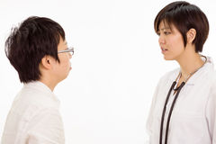 Asian female doctor talking to patient Stock Images