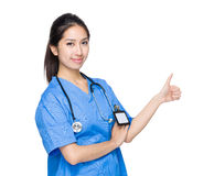 Asian female doctor with thumb up Stock Photography