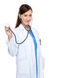 Asian female doctor use stethoscope Stock Photo