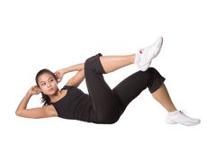 Asian female doing sit ups Royalty Free Stock Image