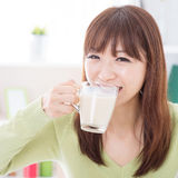 Asian female drinking milk royalty free stock photography