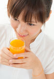 Asian female drinking orange Stock Images