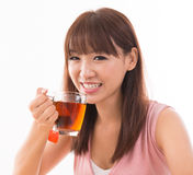 Asian female drinking tea Royalty Free Stock Photo