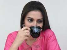Asian female drinking tea Royalty Free Stock Photography