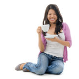 Asian female drinking tea Stock Photography