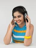 Asian female enjoying music. Asian female of indian origin enjoying music Stock Photos