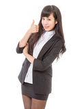 Asian female executive with thumbs up Stock Photos
