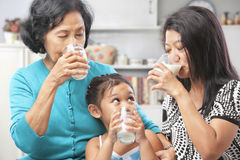 Asian female generations drinking milk Royalty Free Stock Photography