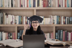 Asian female graduate has idea at library Stock Image