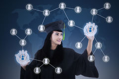 Asian female graduate networking touchscreen Stock Photos