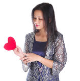 Asian Female With Heart Sign IV. Asian female with Valentine heart object over white background royalty free stock images