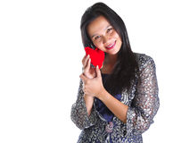 Asian Female With Heart Sign VI. Asian female with Valentine heart object over white background stock image