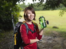 Asian Female hiker taking a rest and having water stock photos