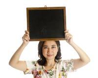 Asian female holding blackboard. Isolated on white background Royalty Free Stock Photos