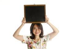 Asian female holding blackboard. Isolated on white background Stock Image