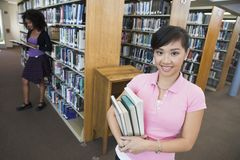 Asian Female Holding Books Stock Photo