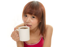 Asian female holding coffee cup on isolated white  Stock Image