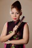 Asian female holding a folding fan Stock Image