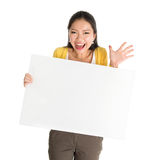 Asian female holding white blank paper card Stock Image