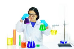 Asian female medical technologist working in laboratory. Asian female medical technologist working with chemical in research laboratory Royalty Free Stock Photos