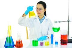 Female lab technician working in medical laboratory. Asian female medical technologist working with chemical in research laboratory Royalty Free Stock Images