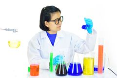 Asian female medical technologist working in laboratory. Asian female medical technologist working with chemical in research laboratory Royalty Free Stock Photography