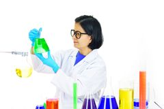 Asian female medical technologist working in laboratory. Asian female medical technologist working with chemical in research laboratory Royalty Free Stock Images