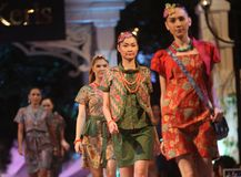 Asian female model wearing batik at fashion show runway Royalty Free Stock Image