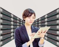 Asian female network engineer in server room, original design elements. Asian female network technician with servers, original design elements royalty free stock image