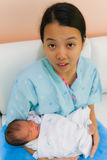 Asian female with newborn in arms. Asian female with sleeping newborn in her arms Stock Photography