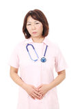 Asian female nurse. With hands crossed Stock Image