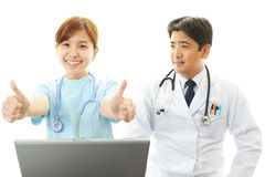 Asian female nurse and doctor Stock Image