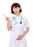 Asian female nurse pointing Royalty Free Stock Images