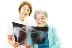 Asian female nurse and senior Stock Images