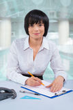 Asian female office worker sketching Stock Images