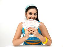 Asian female origin with currency notes Royalty Free Stock Photos