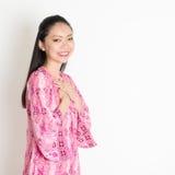 Asian female in pink batik dress Stock Photography