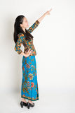 Asian female pointing Royalty Free Stock Image