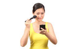 Asian female putting on makeup - Series 3 Stock Image