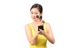 Asian female putting on makeup - Series 4 Royalty Free Stock Image