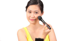 Asian female putting on makeup - Series 2 Royalty Free Stock Image
