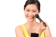 Asian female putting on makeup - Series 3 Royalty Free Stock Photos