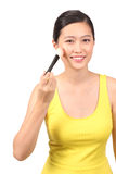 Asian female putting on makeup - Series 4 Royalty Free Stock Photo