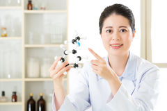 Asian female scientist doing research on touch screen Royalty Free Stock Photo
