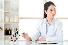 Asian female scientist doing research on touch screen Stock Image
