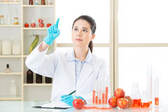 Asian female scientist drop the cure for genetic modification Royalty Free Stock Images