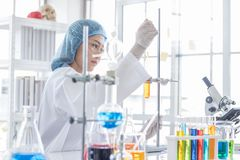Free Asian Female Scientist During Study Chemicals Royalty Free Stock Photography - 138895237
