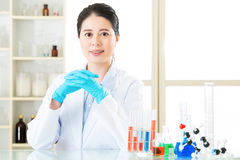 Asian female scientist know the answers are all in the details Stock Images